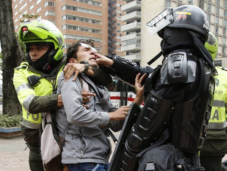 Police in Colombia break up legalization rally after protestors light up